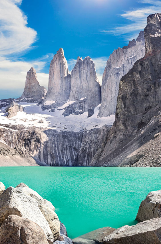 7. Hike Torres Del Paine of Patagonia in Chile. See giant granite towers that form a striking backdrop to a glacial lake, creating one of the most spectacular sights sights you'll ever see. This adventure and 24 others are waiting for you on our blog.