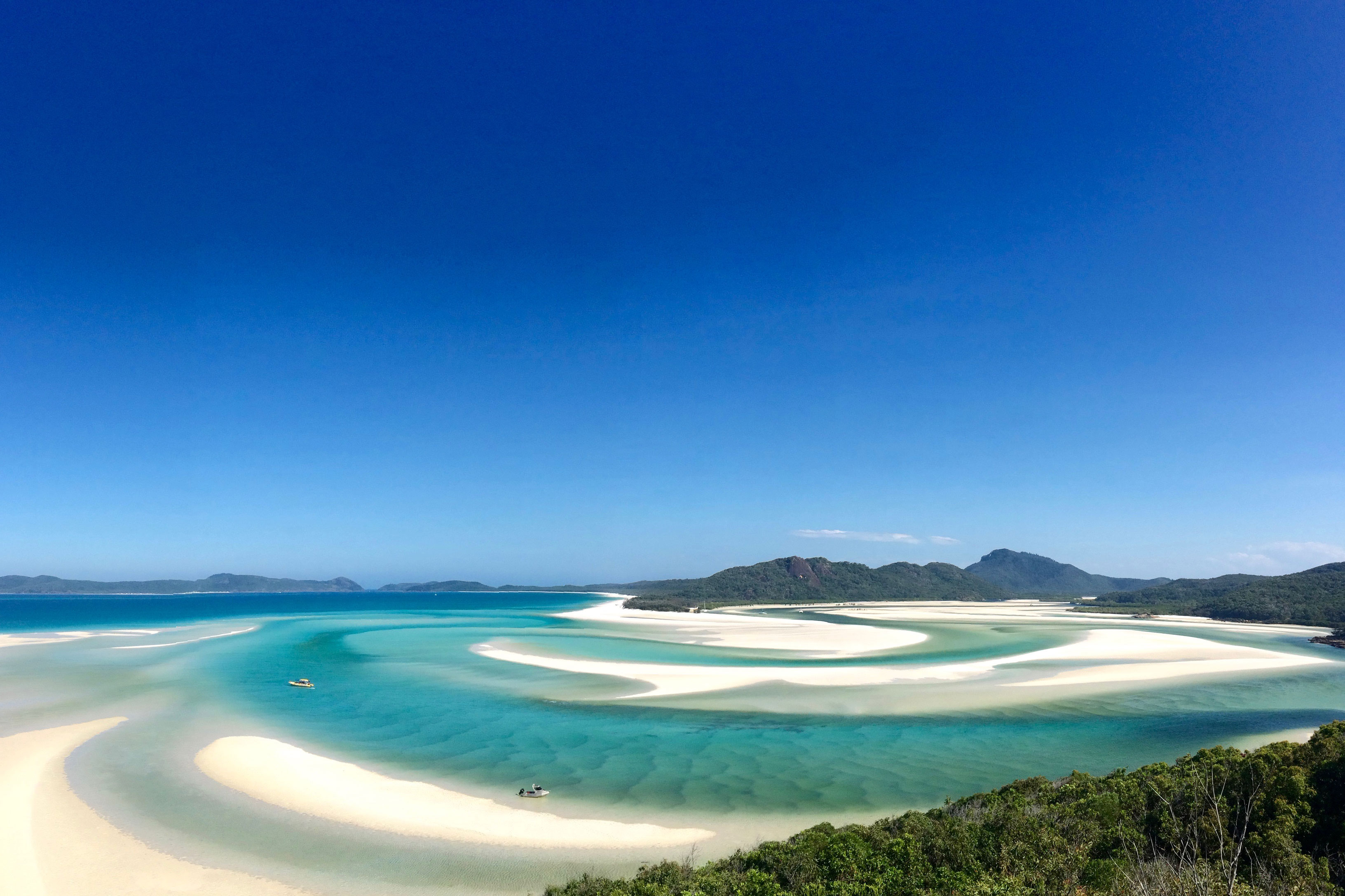 landscape of beautiful blue ocean waters and sand