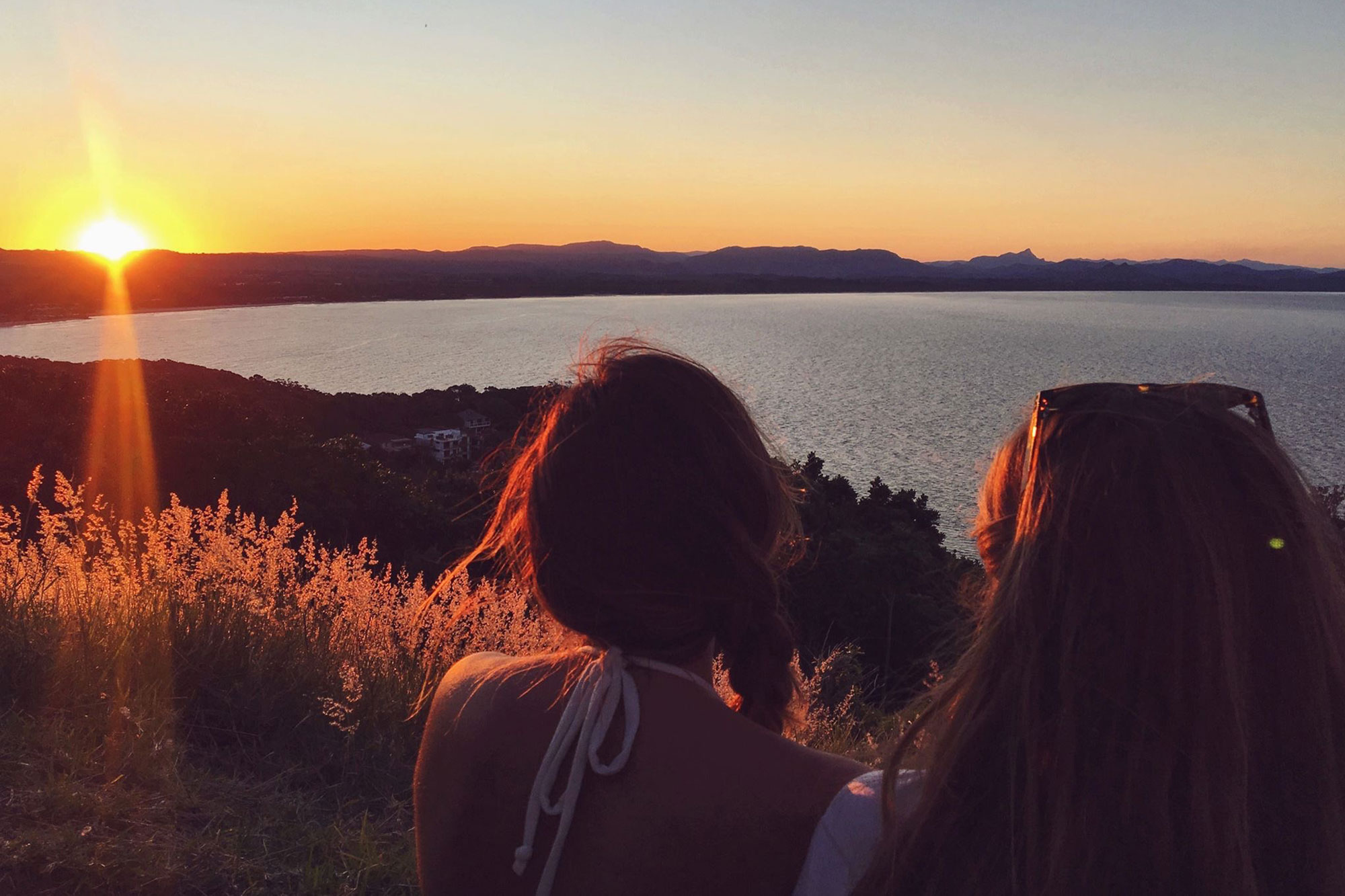 Two girls staring at the sunset