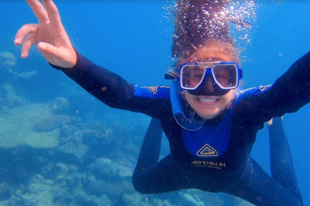 Girl snorkeling underwater