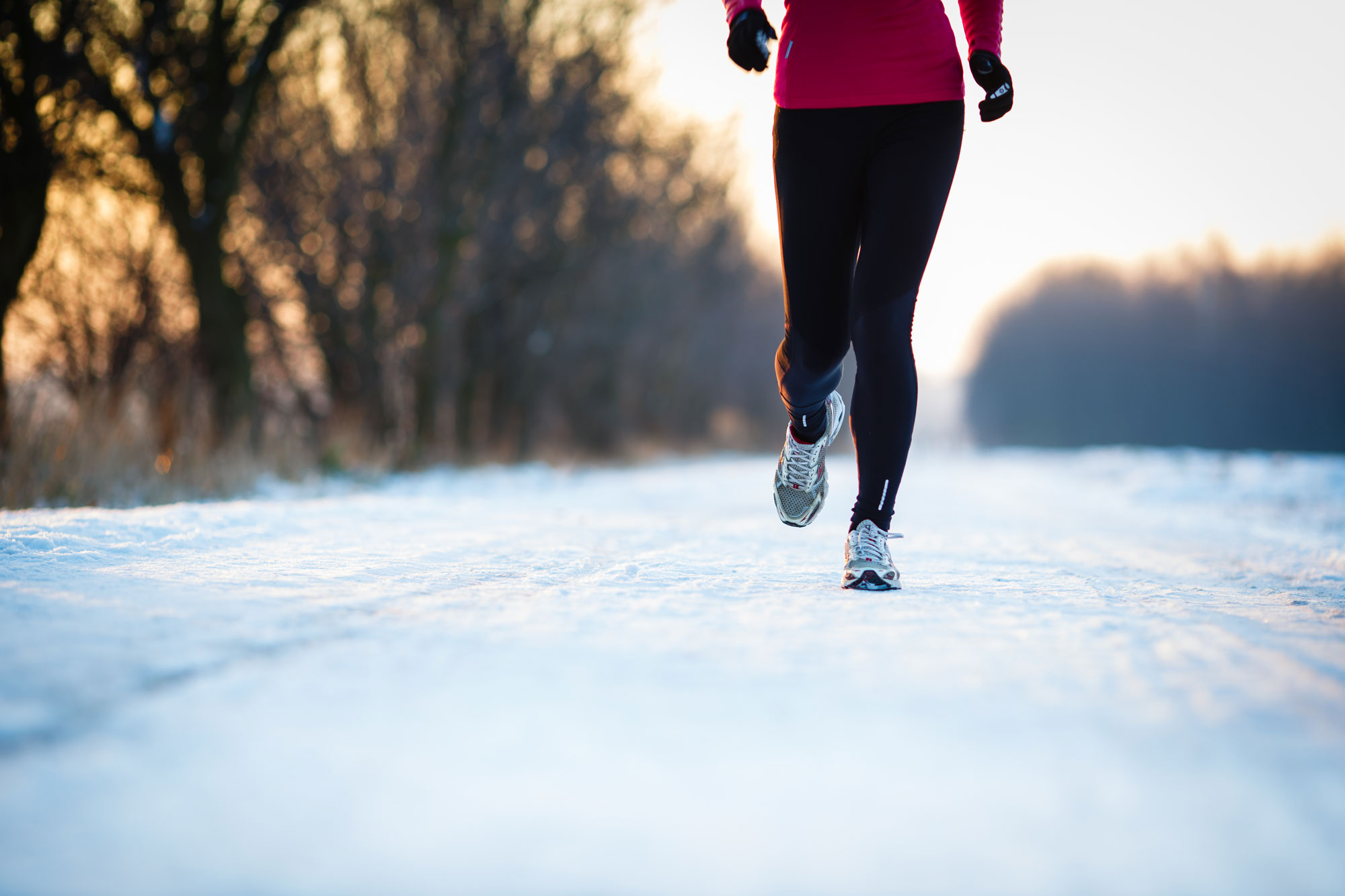 A runner jogging through snow