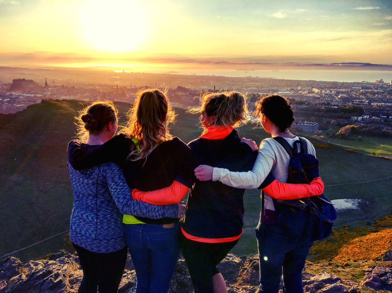 Photo of friends watching the sunset from Arthur's Seat