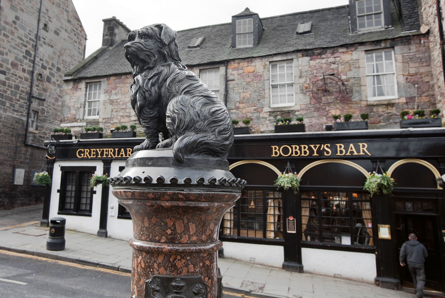 statue of a Skye Terrier named Bobby at the corner of Candlemaker's Row and St. George's Bridge
