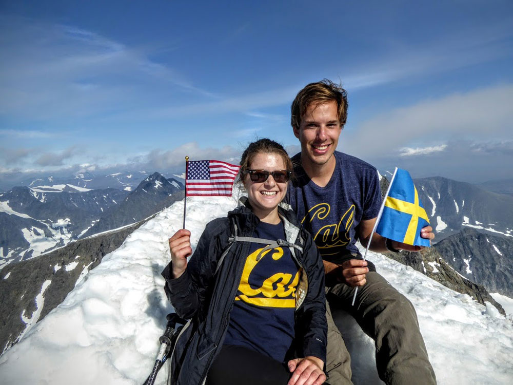 Photo of two Berkeley students at the top of a mountain in Switzerland