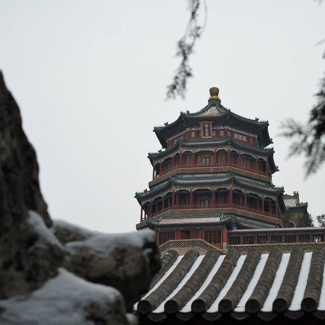 Summer palace with snow on the rooftops