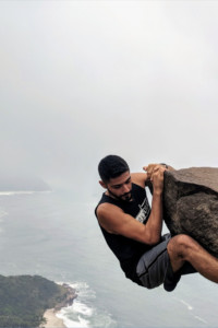 Ricardo hanging off a rock in Brazil