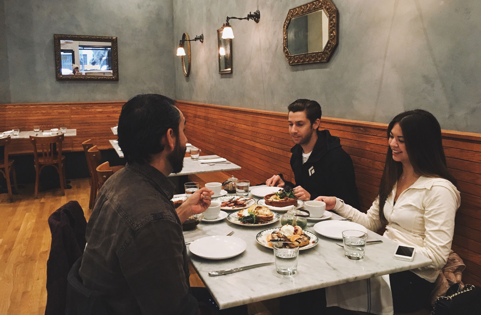 students sitting at a table out to dinner