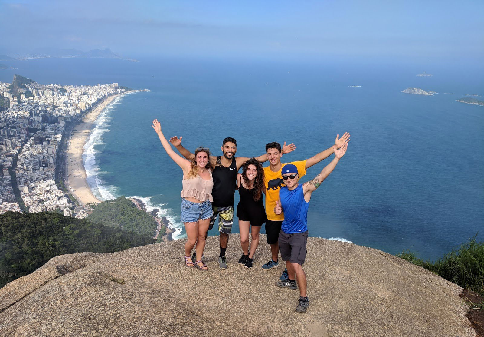 Photo of Ricardo with friends on a mountain top in Brazil