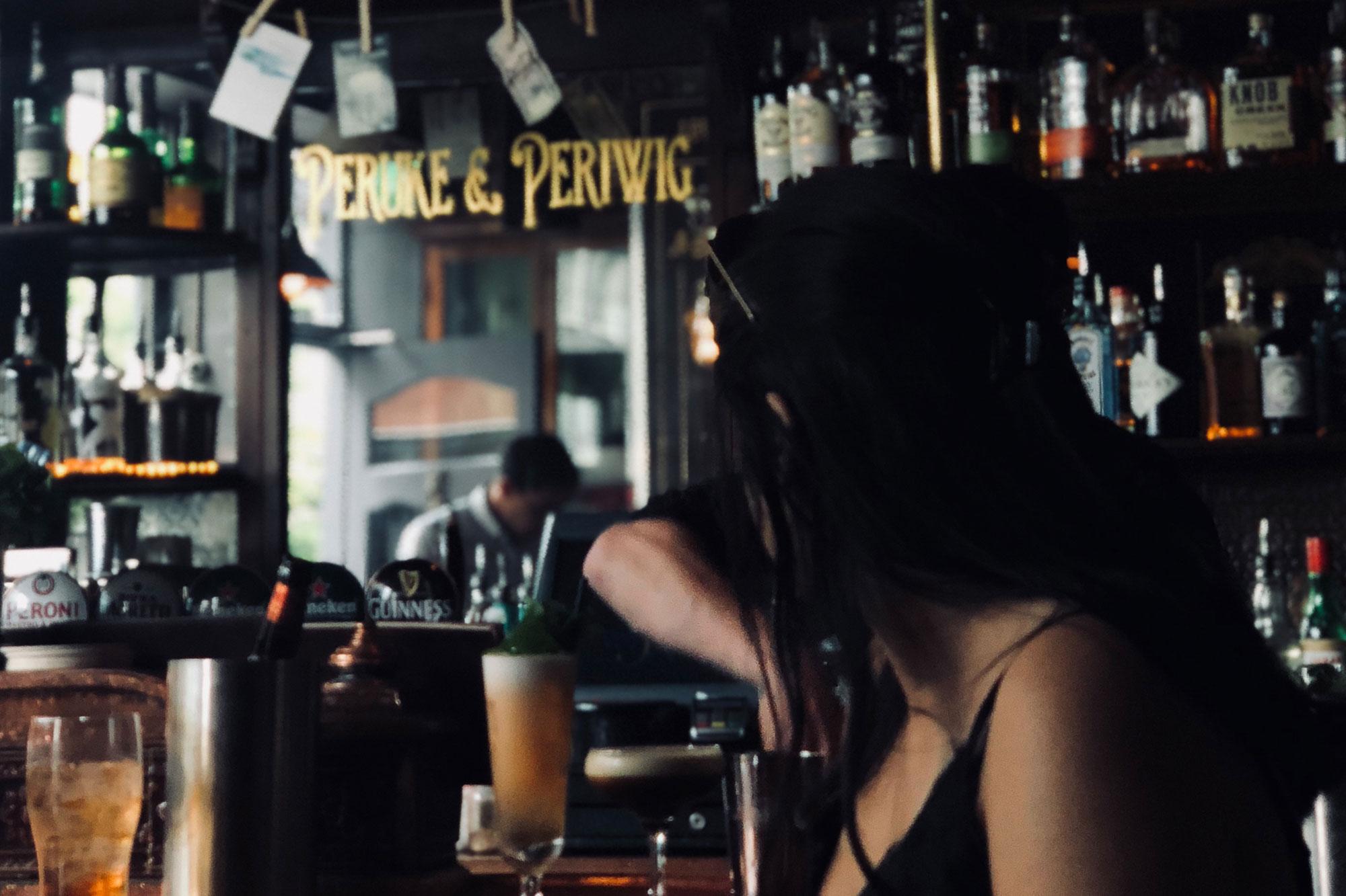 Bianca sitting at a pub in Dublin, Ireland