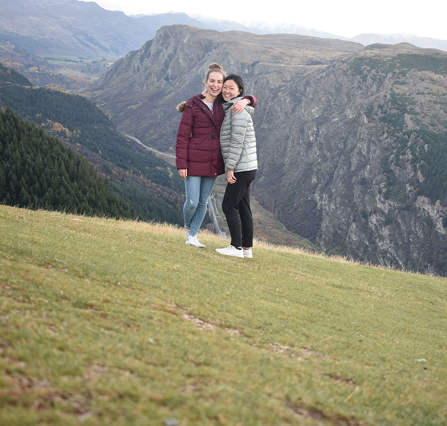 Waresa and friend smiling for a photo in the hills
