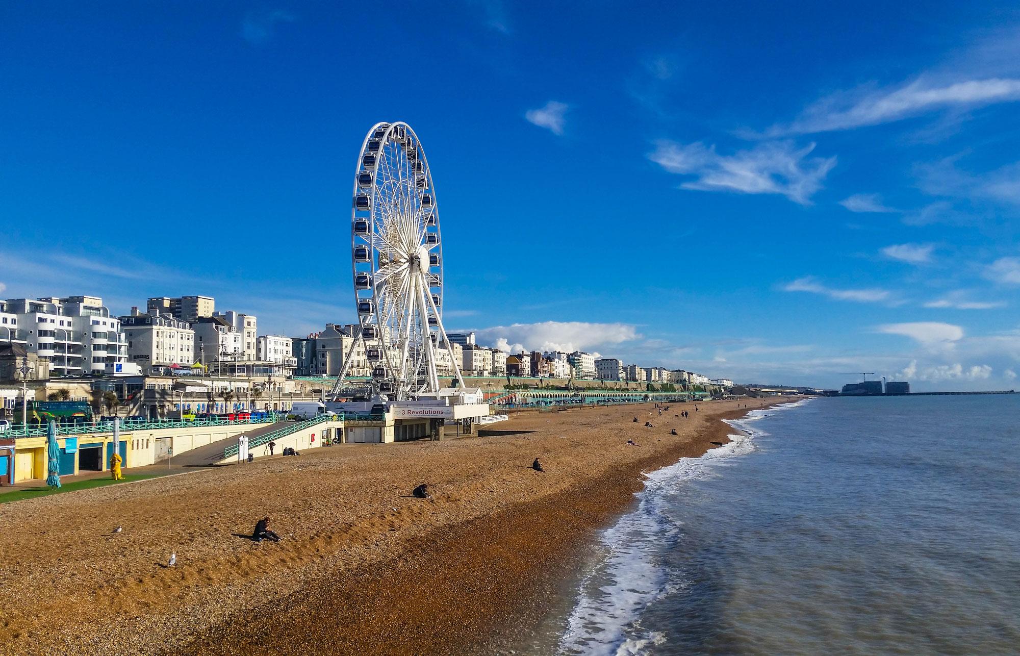 panoramic view of Brighton beachfront with ferris wheel.