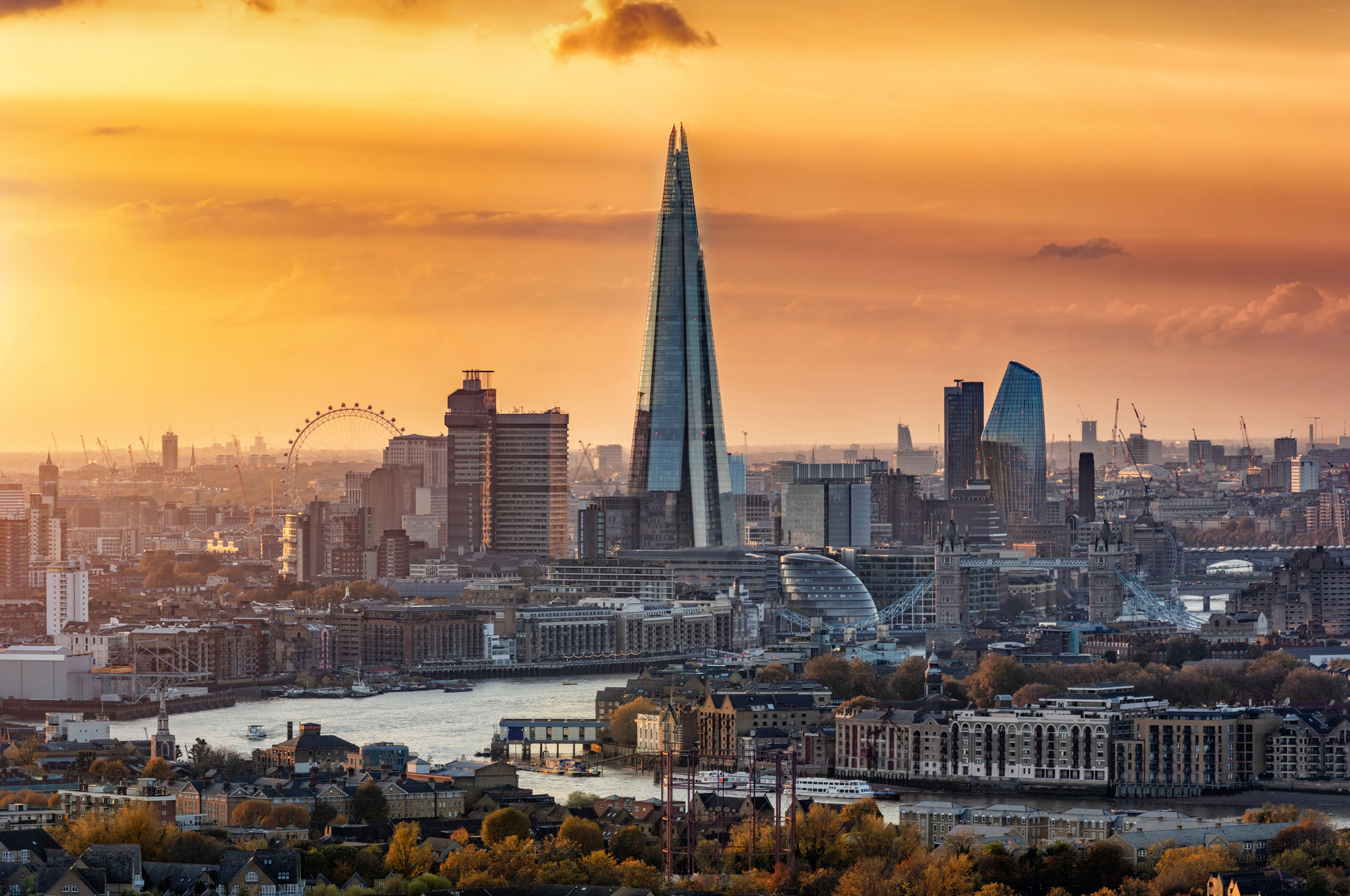 View to the modern skyline of London, United Kingdom, in autumn during sunset time with all the popular tourist attractions