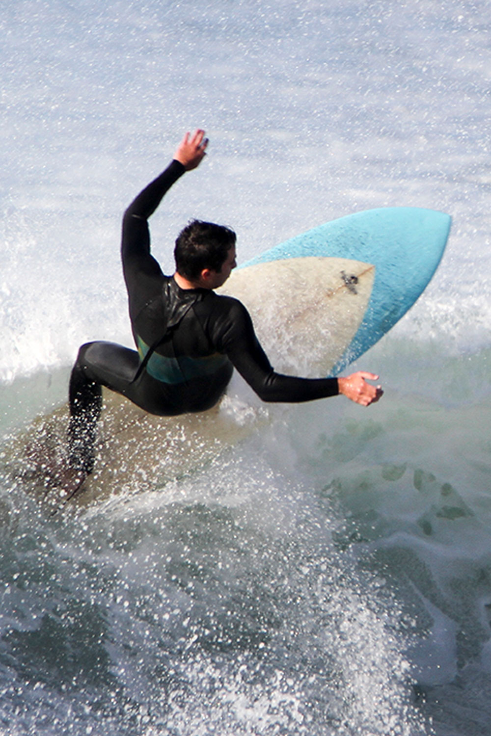Male student catching a wave