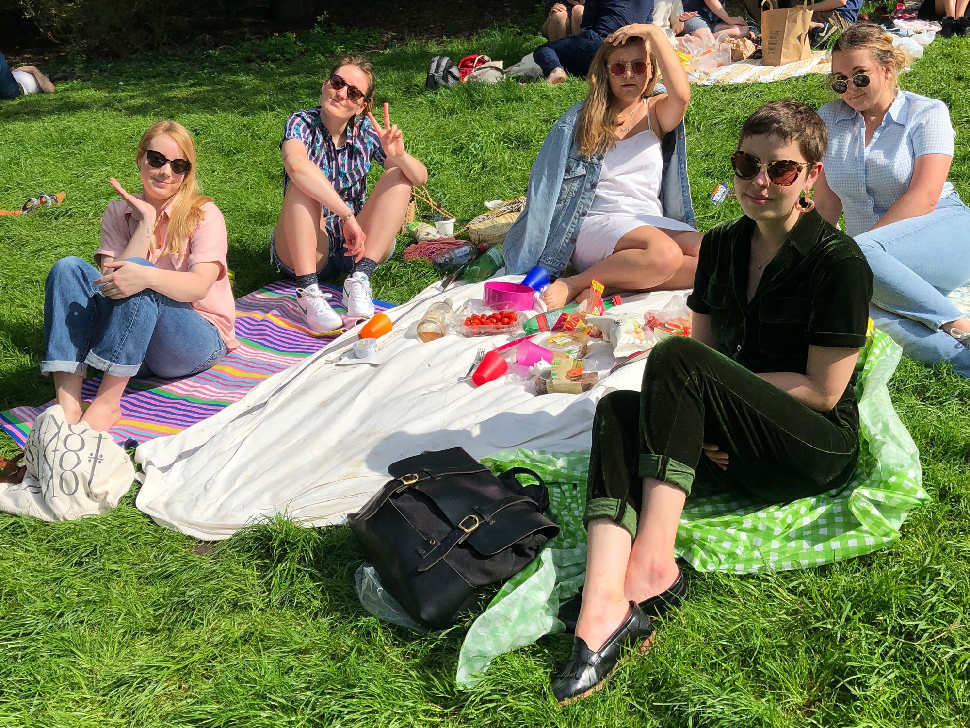Six students enjoying a picnic in Paris France.