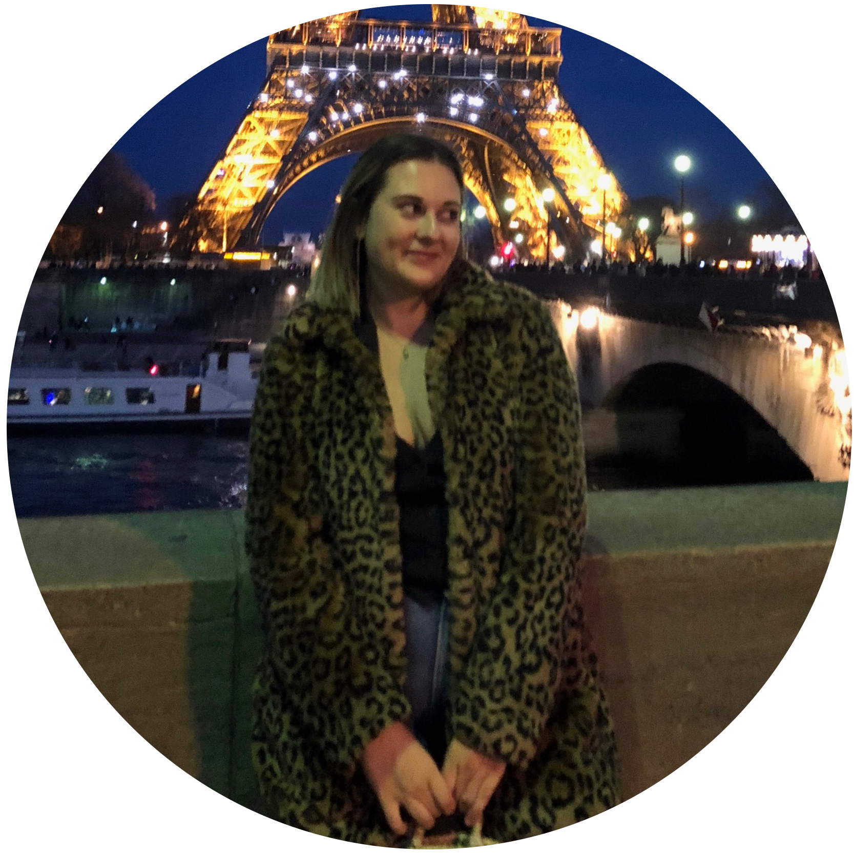Liz Lemerand in front of the Eiffel Tower in Paris France.