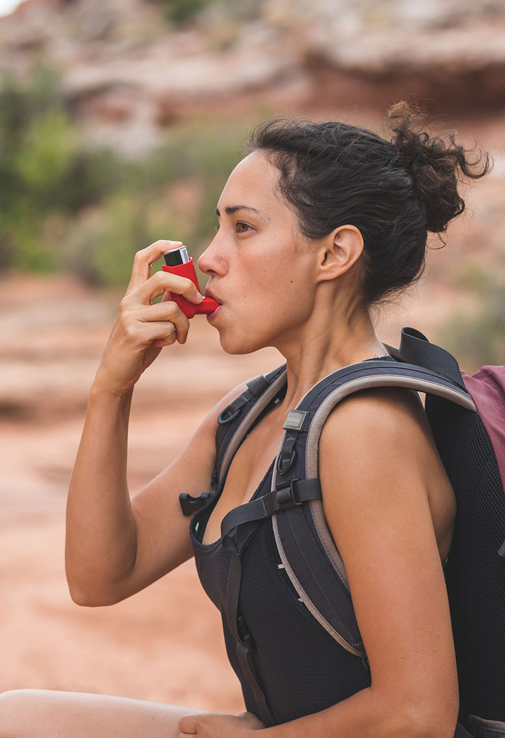 Woman With Chronic Asthma Hiking in Desert