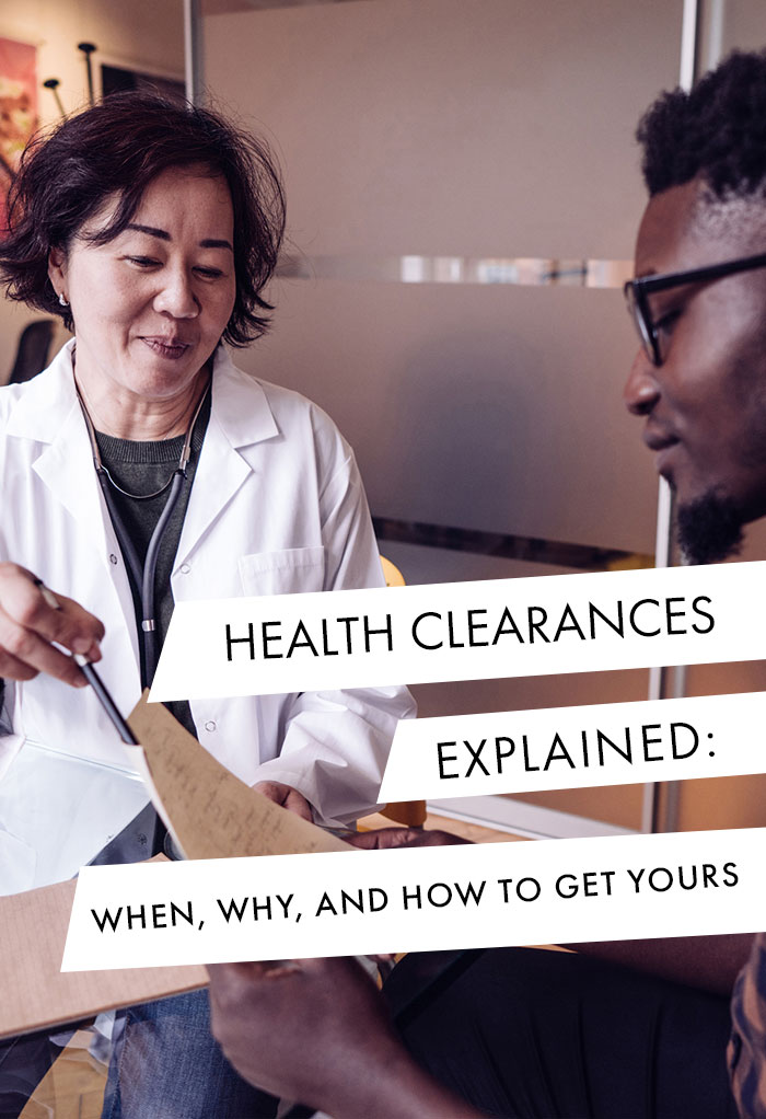 Woman doctor consulting with male patient about health clearance.