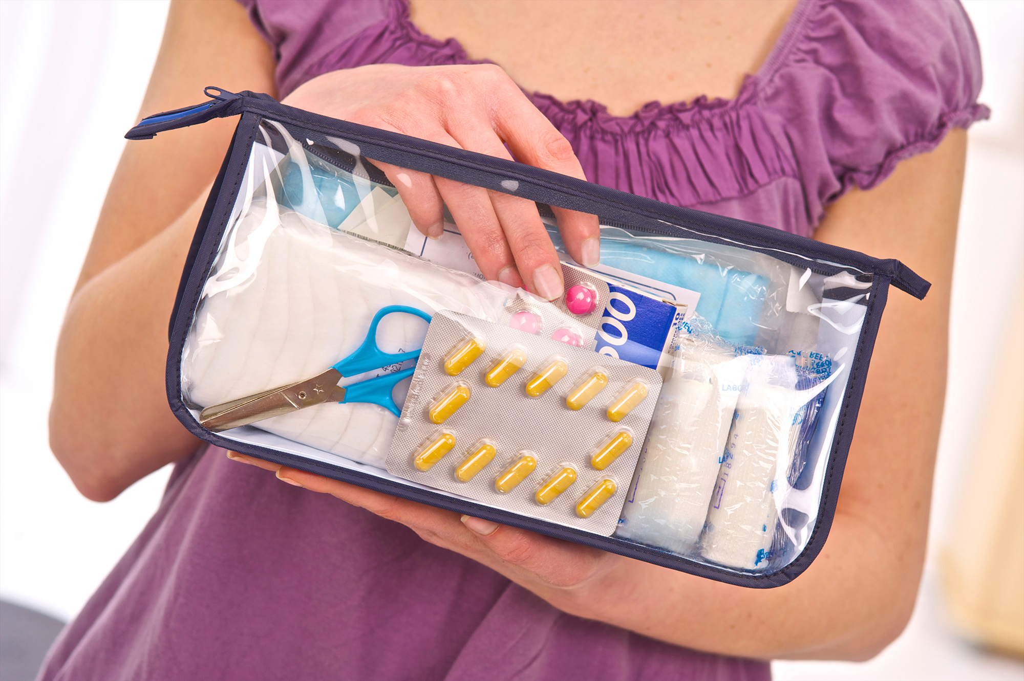 Woman holding travel health kit