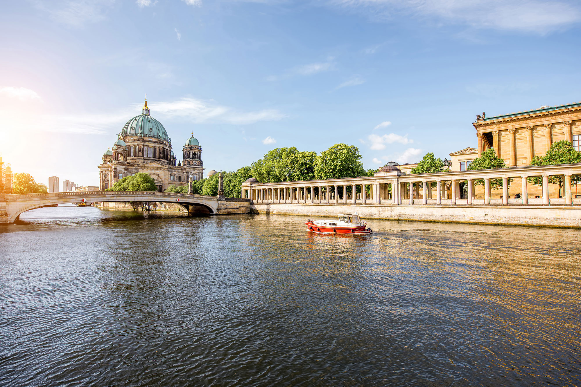 Sunrise view on the riverside with a National gallery building and cathedral in the old town of Berlin city.