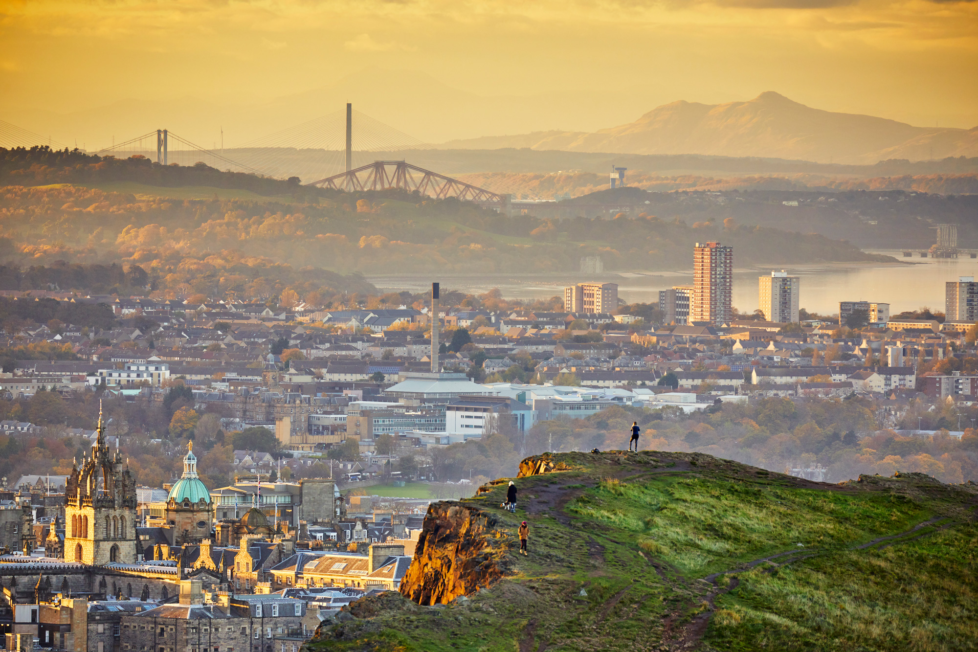 Edinburgh cityscape and skyline with Firth of Forth at sunset from Holyrood Park