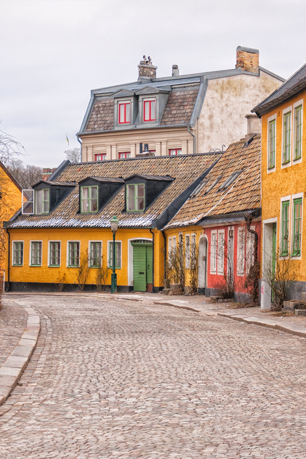 Cobblestone pathway and traditional houses in Lund Sweden