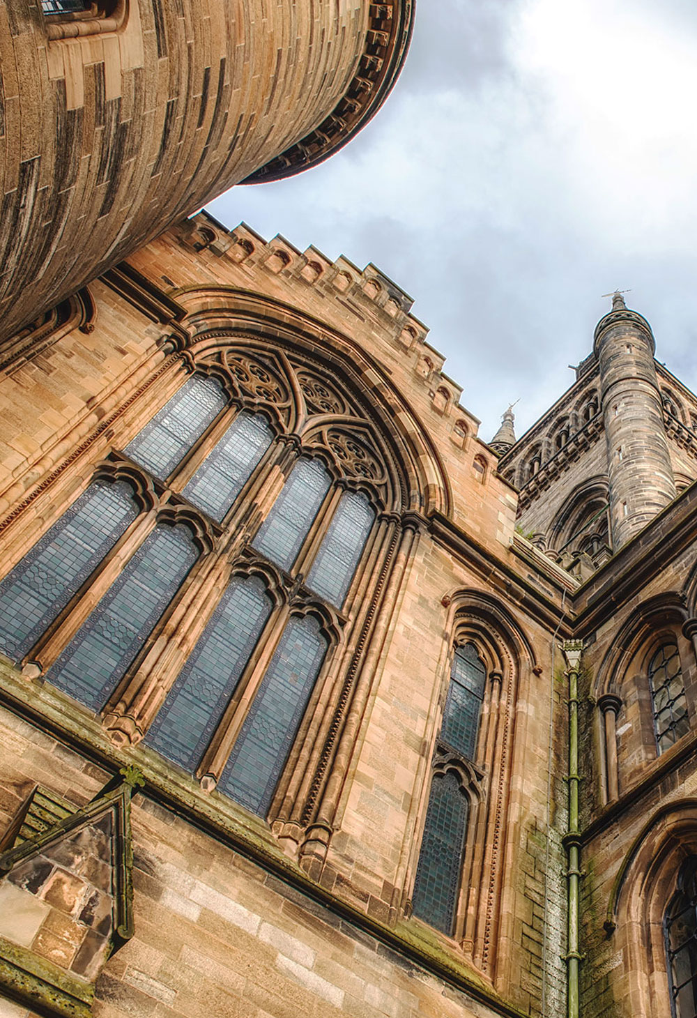 View looking up at exterior of the Main Building of the University of Glasgow, Scotland