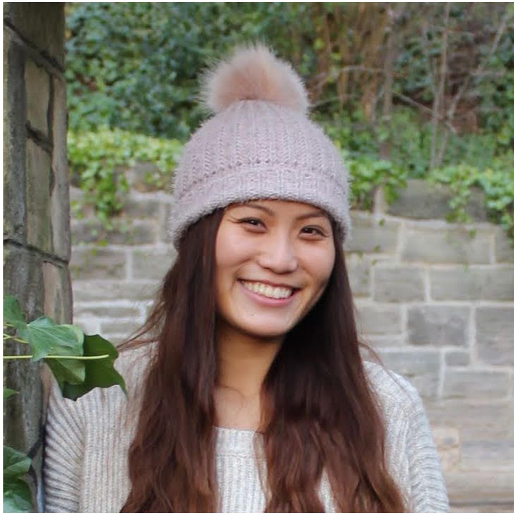 Christina Choy smiling at the camera
