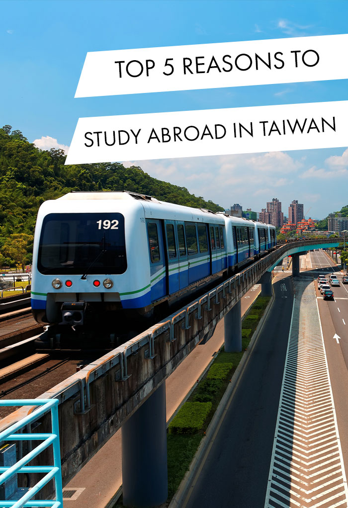 View of a train traveling on elevated rails of Taipei Metro System in suburban area under blue clear sky ~ View of railways in Mucha, Taipei, the capital city of Taiwan, on a beautiful sunny day