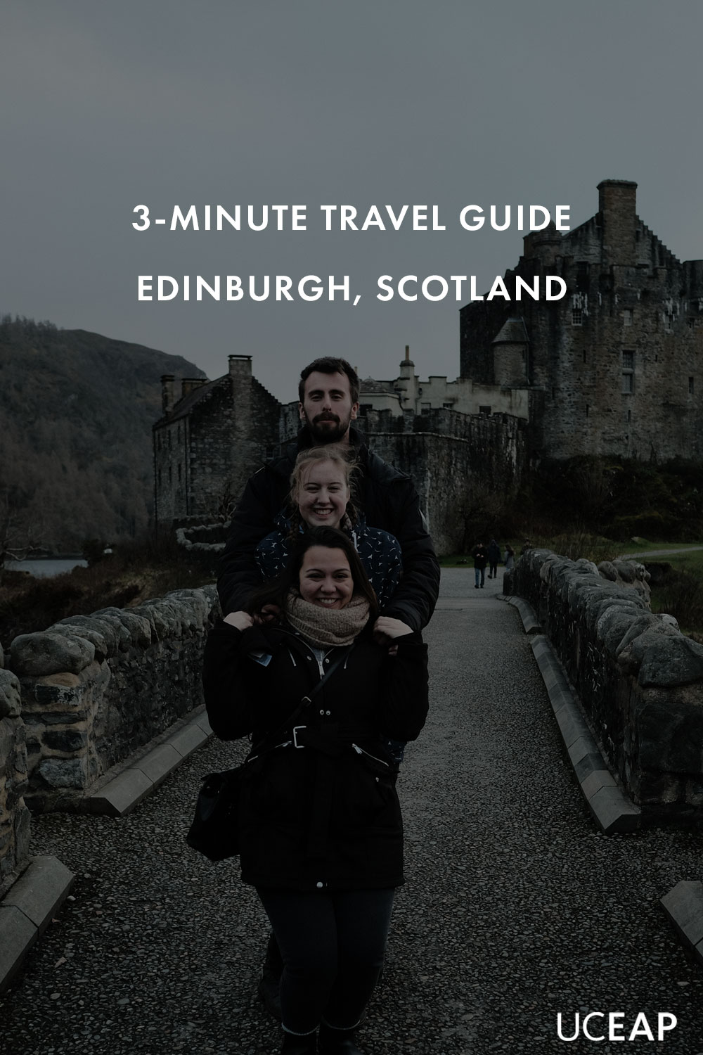 3 students pose for a photo at Eilean Donan Castle in Scotland.