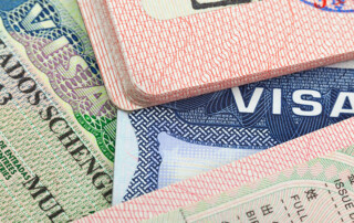 Closeup of Chinese, USA and Shengen European visas in passports