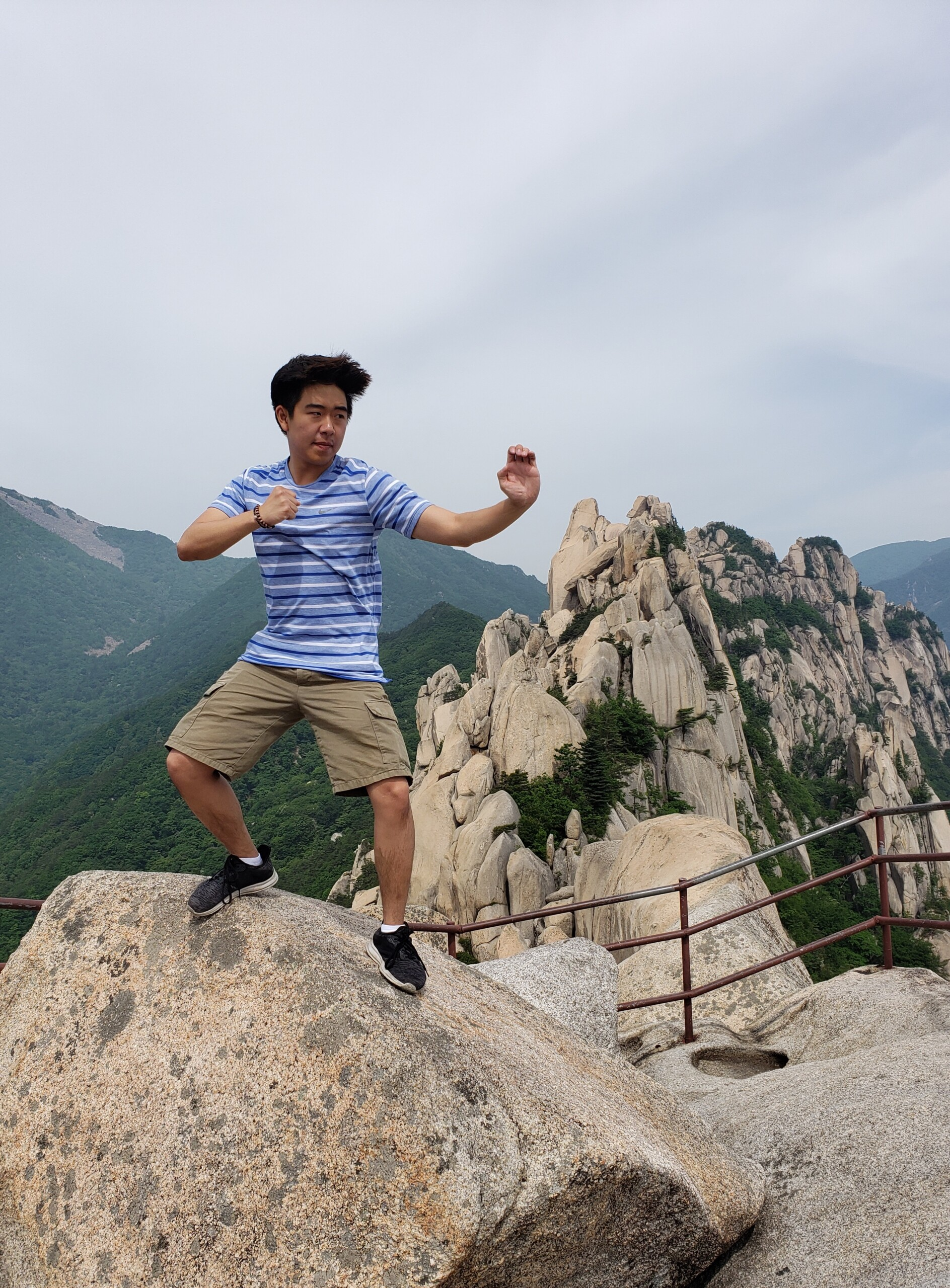 Brandon Yoon poses atop a rock on Seorak Mountain.