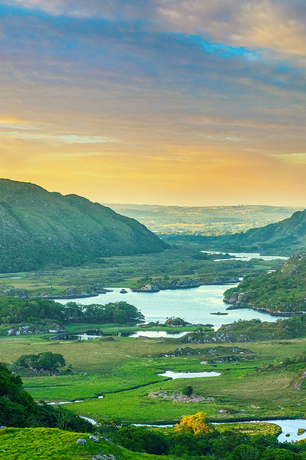 View of mountains and lakes at sunset overlooking the Ring of Kerry from the Ladies View, Killarney National Park, Ireland.