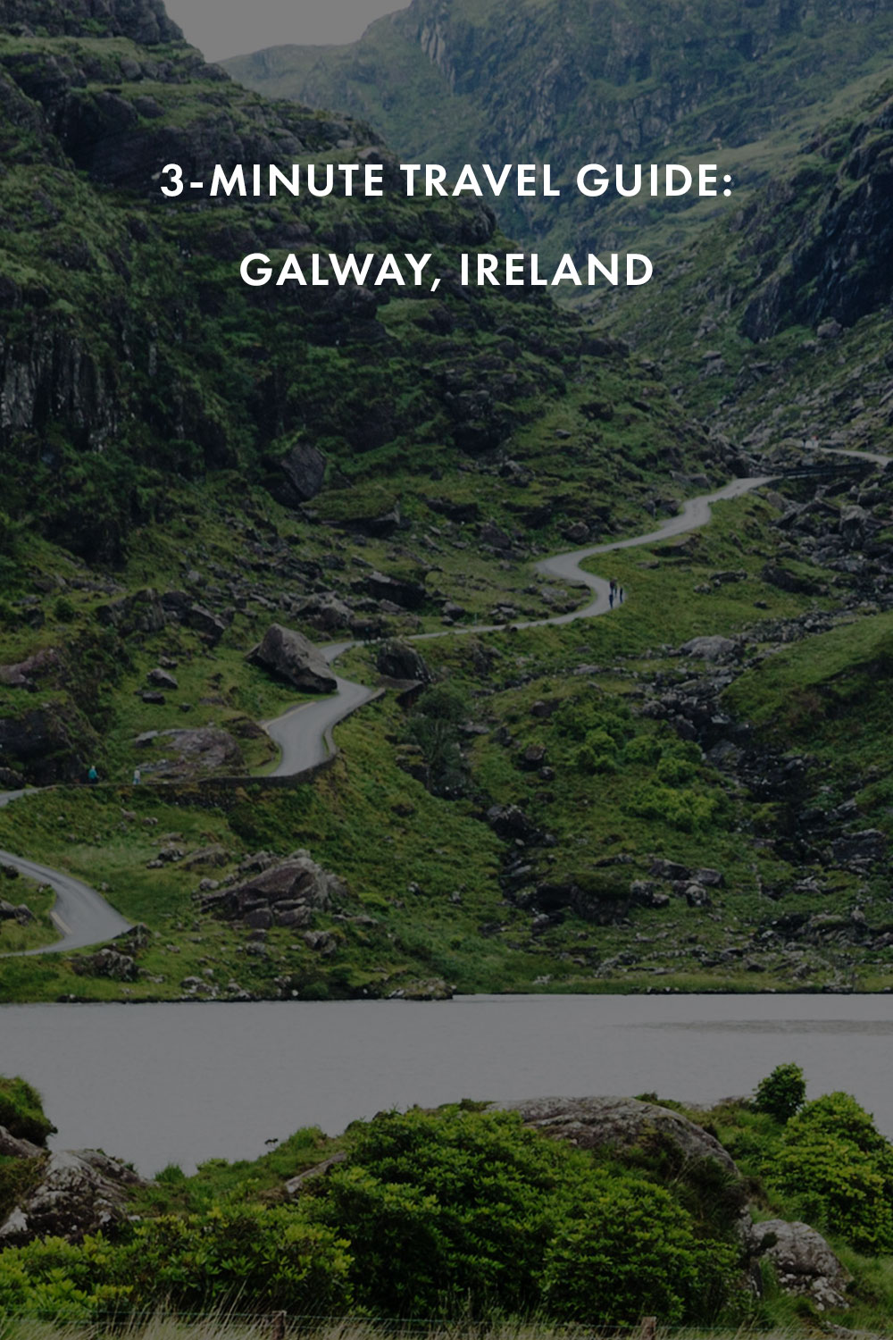 Green rugged mountain pass with windy road and lake at the Gap of Dunloe in County Kerry, Ireland.