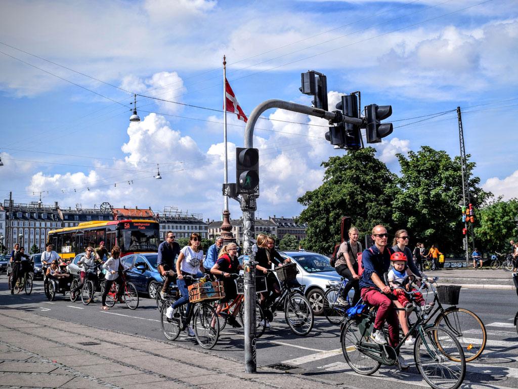 Public transportation at a busy intersection in Copenhagen, Denmark.