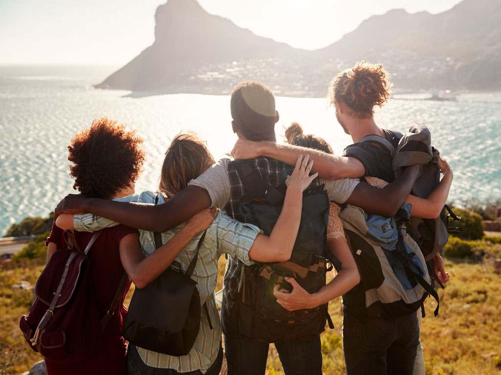 Five friends linking arms and enjoying the view in Cape Town South Africa